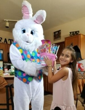 Easter-Bunny with a special customer getting a Easter Basket