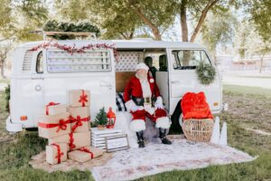 Santa Zippy sitting on VW Bus